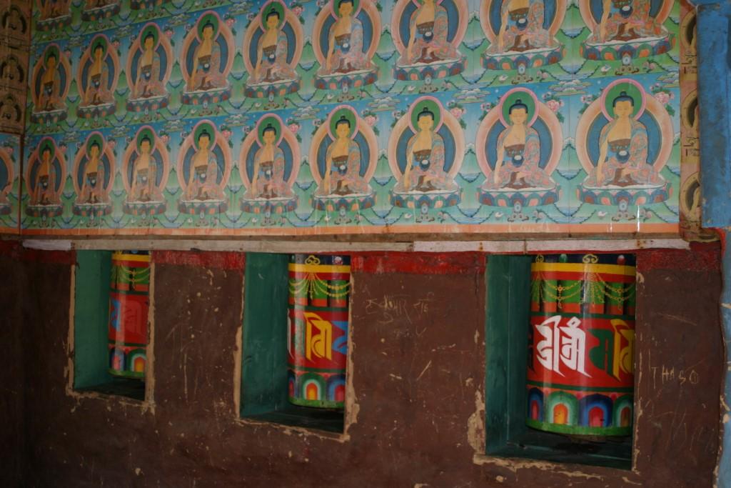 Prayer wheels and paintings inside a chorten