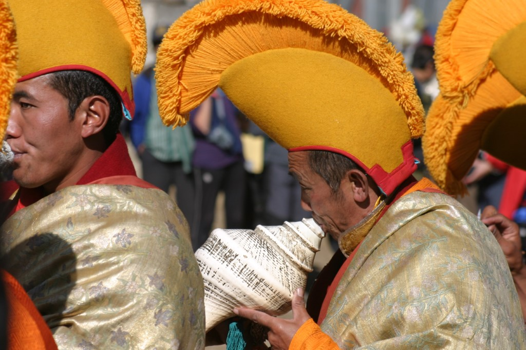Monk blowing horn