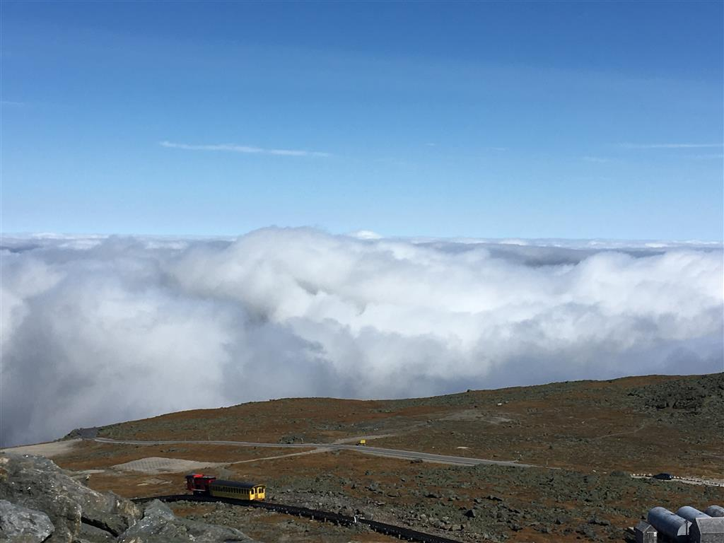 The view from the summit of Mt Washington, with the chain-driven train