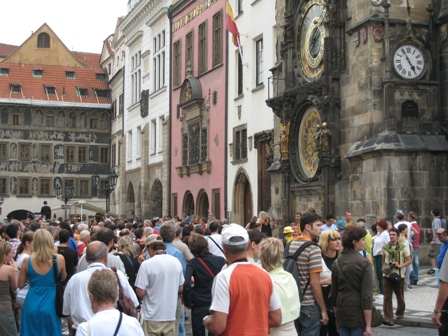 Crowds gather to watch the Astronomical Clock do its thing…