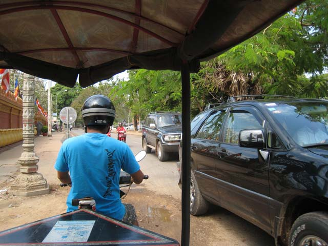 In Cambodia, they drive on the right, and this is a one-way street. Guess which way...