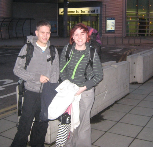Laura and Chris outside Manchester Airport at the start of their Round-the-World adventure