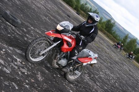 Tracy sliding the rear on her BMW F650GS…