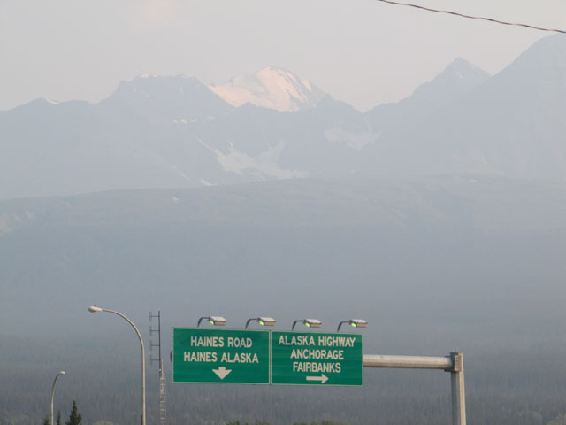 The smoke haze almost obscures the mountains from view...