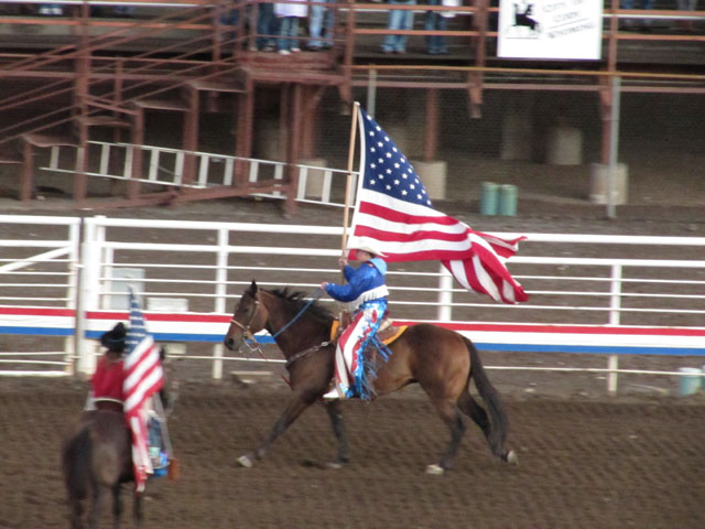 Parading the Stars 'n' Stripes at the start of the rodeo...