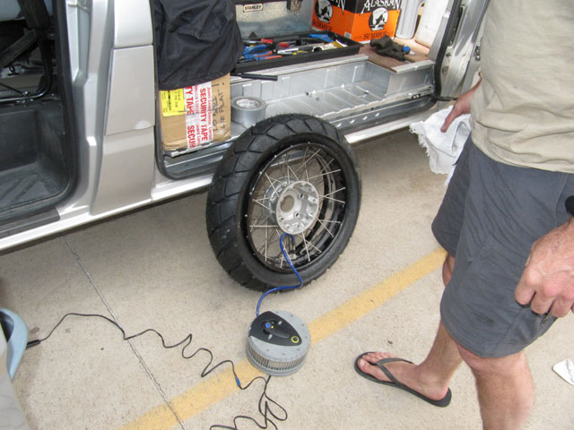 Step 8: Inflate the tyre using a compressor, hoping that it will force the bead onto the rim...