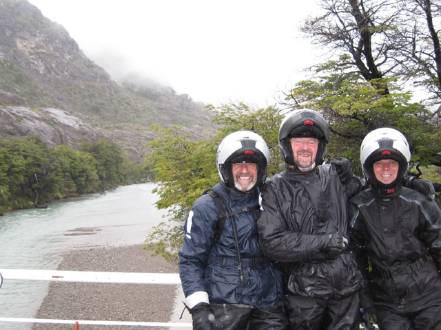 Gerald, Tony and Phil smiling in the rain...