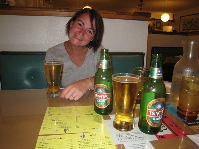 Tracy enjoys a cold beer waiting for her Chinese in Cortez