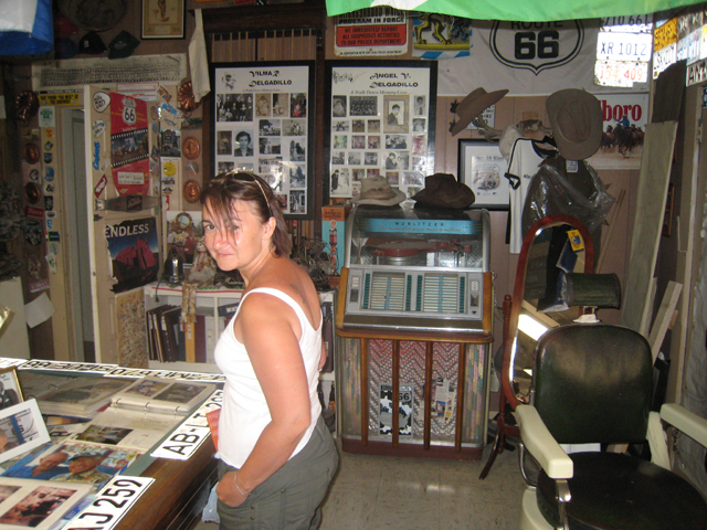 Tracy inside Angel's famous barber's shop turned museum, Seligman, Route 66…