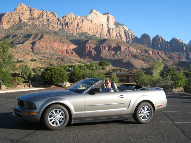 Paul posing in the Mustang outside Majestic View Lodge